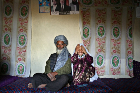 Said Mohammed, 55, and Roshan Kasem, 8, on the day of their engagement in the village of Chavosh on Sept. 10, 2005. The father of the bride, Abdul Kasem, 60, said he is unhappy giving his daughter away at such a young age, but has no choice due to severe poverty.