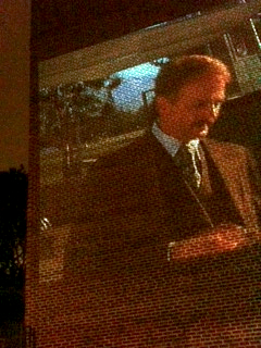 Movie being projected on the side of the brick building