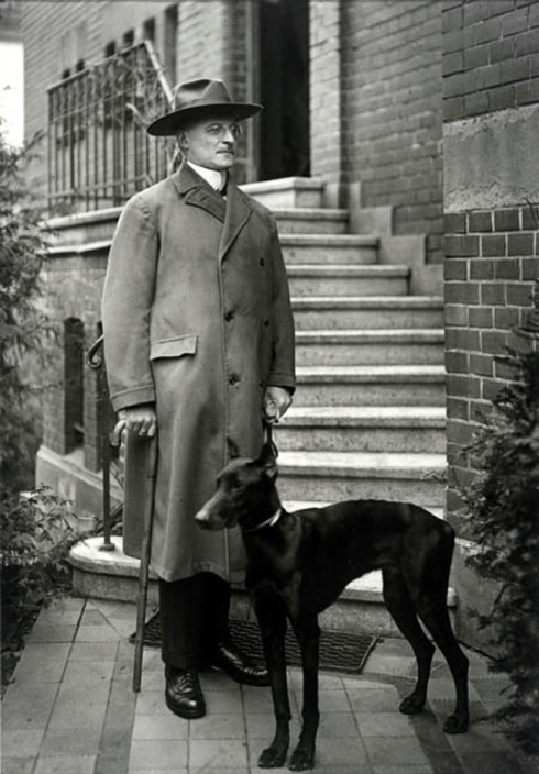 August Sander portrait of a man with dog