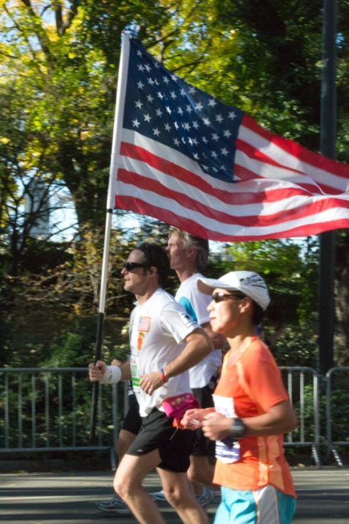 This man ran with a large U.S. flag